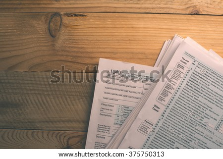 U.S. Individual income tax return document on the wooden desk - stock photo