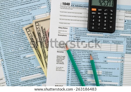 U.S. individual income tax return form 1040 with business tools - stock photo