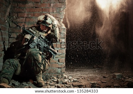 U.S. marine hiding from explosion - stock photo