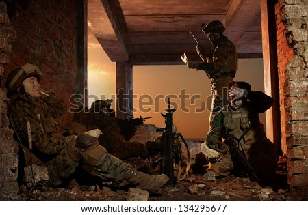 U.S. Marines on a halt. Sunset sky. Good day in the war. - stock photo