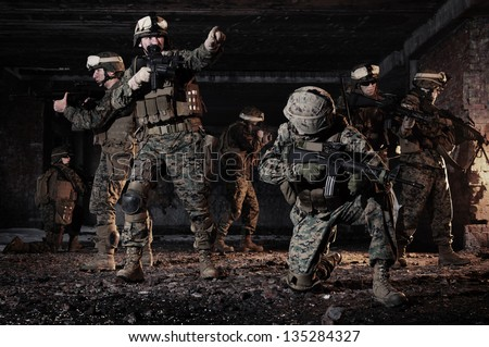 U.S. Marines took a defensive position in the building. - stock photo