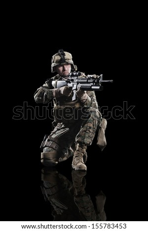 U.S. military marine. Studio shooting. with reflections. sitting pose. isolated. With alpha channel - in my gallery. - stock photo