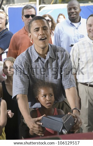 U.S. Senator Barak Obama campaigning for President with his daughter at Iowa State Fair in Des Moines Iowa, August 16, 2007 - stock photo