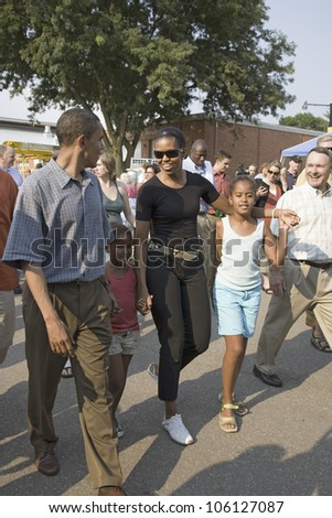 U.S. Senator Barak Obama campaigning for President with wife Michelle Obama and daughter at Iowa State Fair in Des Moines Iowa, August 16, 2007 - stock photo