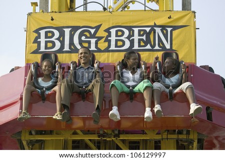 U.S. Senator Barak Obama taking ride on Big Ben with his daughters while campaigning for President at the Iowa State Fair in Des Moines Iowa, August 16, 2007 - stock photo
