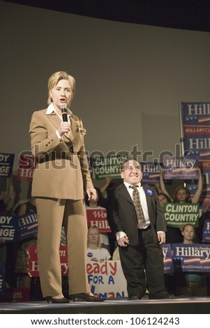 U.S. Senator, Former First Lady and Presidential Candidate, Hillary Clinton next to a midget at rally, following Iowa Democratic Presidential Debate Drake University, Des Moines, Iowa, August 19, 2007 - stock photo