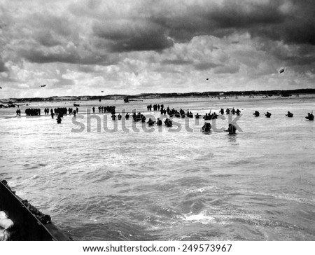 U.S. troops wading to Utah Beach during the D-Day invasion of Normandy on June 6-8, 1944. - stock photo