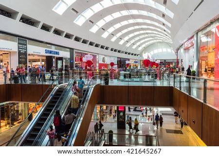 UAE, DUBAI - DECEMBER 25: people do shopping in Dubai Mall store center on December 25, 2014 - stock photo