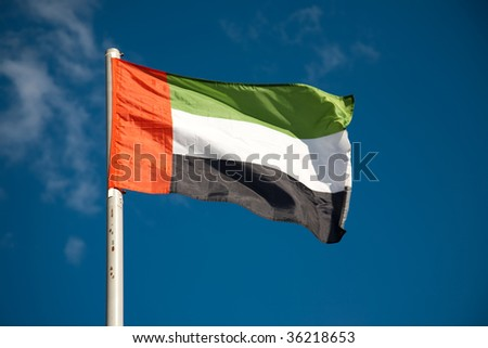 UAE flag against blue sky - stock photo