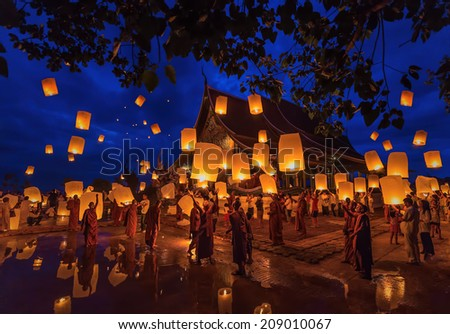 UBONRATCHATHANI, THAILAND - JULY 12 :Loy Khom festival in Chiangmai.Tradition al monk Lights floating balloon made of paper annually at Wat Phu Praw temple.on July 12,2014, Ubonratchathani, Thailand.  - stock photo