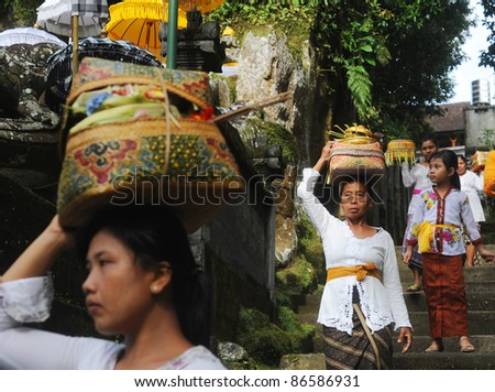 UBUD, BALI, INDONESIA - APRIL 06:  Unidentified local women wearing in traditional indonesian clothes take part in Buda Wage Kelawu ceremony at Hindu temple on April 06, 2011 in Ubud, Indonesia. - stock photo