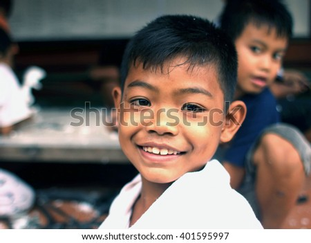 UBUD, INDONESIA - FEB 25, 2016:Unidentified Indonesian child.As of January 2015 the population of 3,891,428 people of Bali island.Indonesia includes numerous ethnic, cultural and linguistic groups. - stock photo