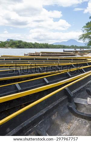 Ucaima port and boats on Carrao river near lagoon of Canaima national park - Venezuela - stock photo