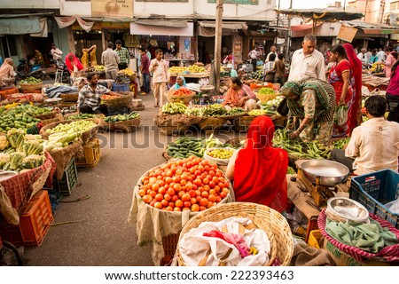 UDAIPUR, RAJASTAN- INDIA :MAY 27 2013 - Unidentified people selling vegetables on a street market on May 27, 2013 in Udaipur, India. - stock photo