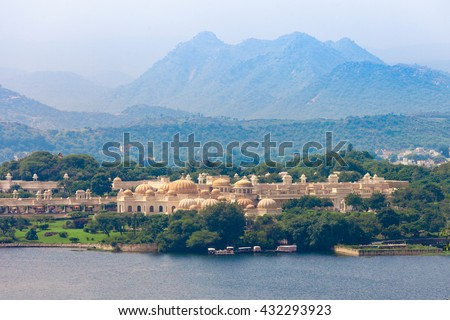 Udaivilas Palace near Pichola lake, Udaipur, India - stock photo