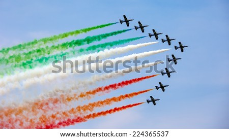 UDINE, ITALY - 01 MAY 2009: The Italian demonstration team Frecce Tricolori performes at the Airshow on May 01, 2009 in Udine, Italy - stock photo