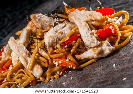 Udon noodles with vegetables and boiled chicken - stock photo