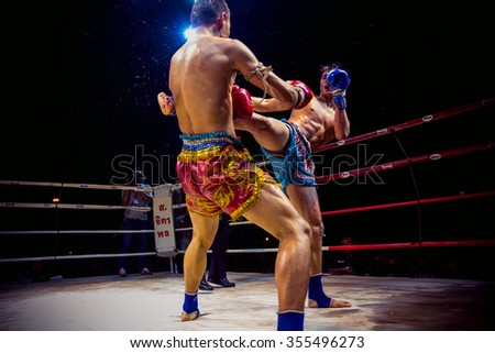 UDONTHANI THAILAND - 9 January 2014 : Admission is free unidentified players in Muay thai on January 9 , 2014 at tung sri maung park Udonthani in Thailand - stock photo