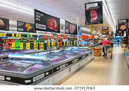 UELSEN, GERMANY - SEPTEMBER 23: Interior of a Lidl supermarket. Lidl is a German discount chain, 9800 stores, in 28 countries in Europe. Photo taken on September 23, 2015 in Uelsen, Germany - stock photo