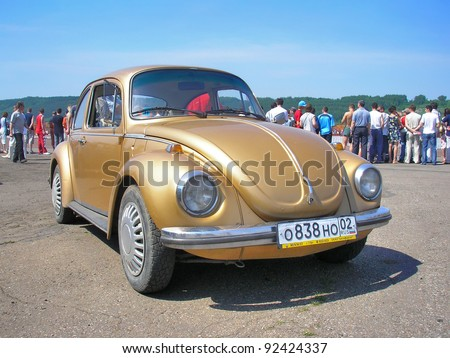 "UFA, RUSSIA - JULY 10: Classic German motor car Volkswagen Beetle exhibited at the annual Motor show ""Maximovka"" on July 10, 2006 in Ufa, Bashkortostan, Russia. - stock photo"