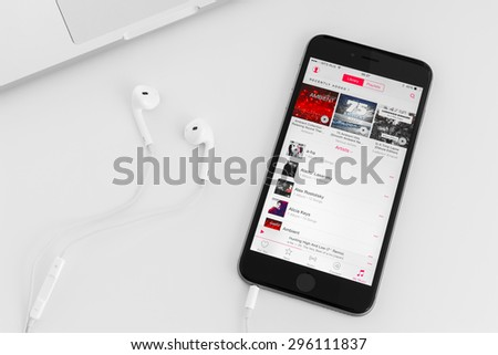 UFA, RUSSIA - JULY 04, 2015: New iPhone 6 Plus is a smartphone developed by Apple Inc. Apple releases the new service for listening music and radio. - stock photo