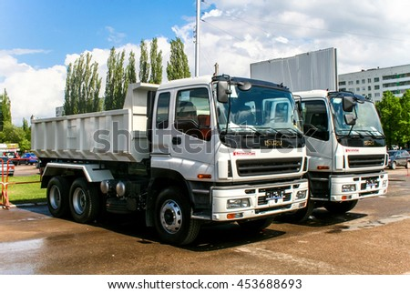 UFA, RUSSIA - MAY 15, 2008: Brand new dump trucks Isuzu CXZ in the city street. - stock photo