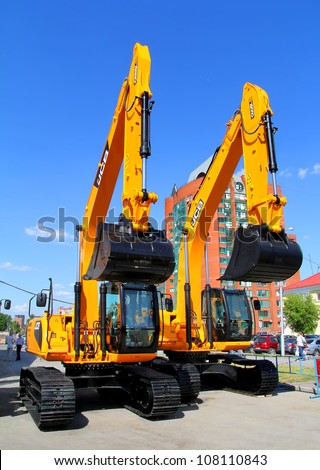 "UFA, RUSSIA - MAY 22: JCB excavators at the annual International exhibition ""Gas. Oil. Technologies"" on May 22, 2012 in Ufa, Bashkortostan, Russia. - stock photo"