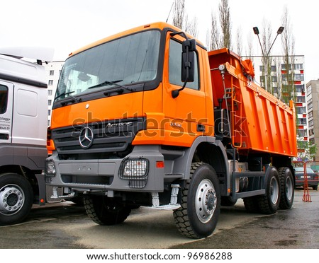 "UFA, RUSSIA - MAY 11: Modern dump truck Mercedes Actros 3336 exhibited at the annual Motor show ""Autosalon"" on May 11, 2011 in Ufa, Bashkortostan, Russia. - stock photo"