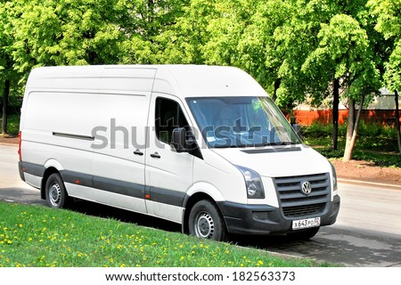 UFA, RUSSIA - MAY 22, 2008: White Volkswagen Crafter cargo van at the city street. - stock photo