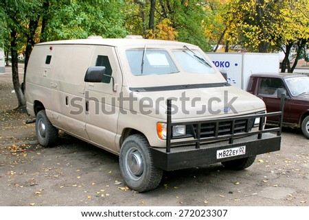 UFA, RUSSIA - OCTOBER 1, 2009: Aged american armored van Ford Econoline at the city street. - stock photo