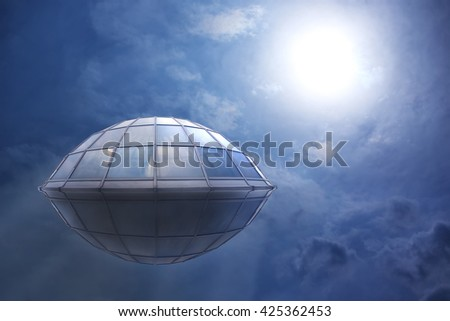 UFO flies in the cloudy sky to the sun - stock photo