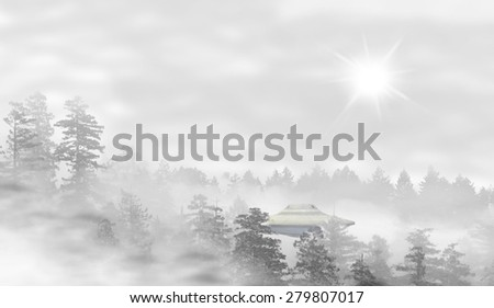 UFO in a landscape of misty forest at sunrise - concept of mystery - stock photo