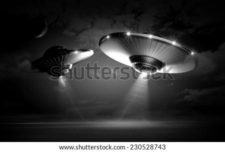 UFO in dark night - stock photo