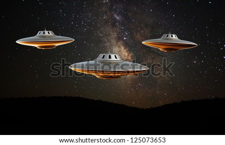 ufo isolated under the stars - stock photo