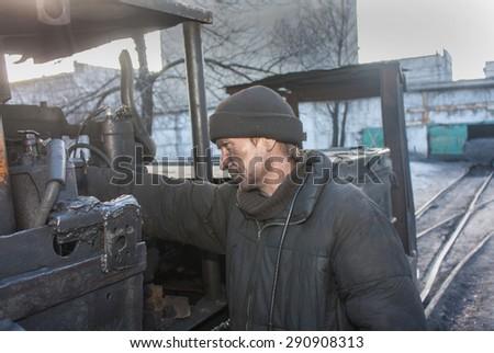 Uglegorsk, Ukraine - March 12, 2014: Driver mine Uglegorskaya near trolley coal mine yard - stock photo