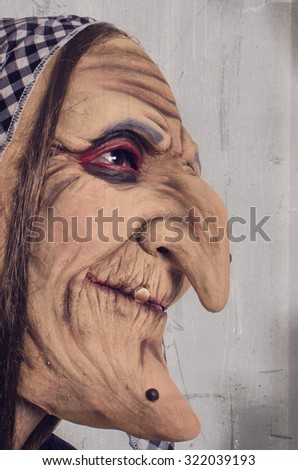 Ugly witch - disguise - stock photo
