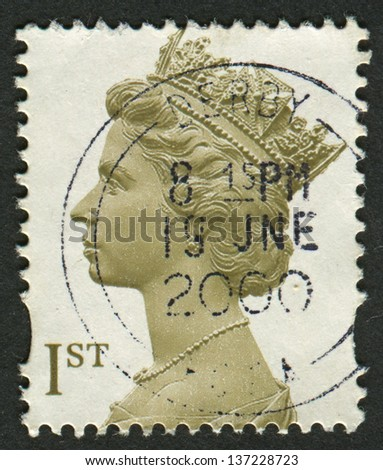 UK-CIRCA 2000:A stamp printed in UK shows image of Elizabeth II is the constitutional monarch of 16 sovereign states known as the Commonwealth realms, in Olive-Brown , circa 2000. - stock photo