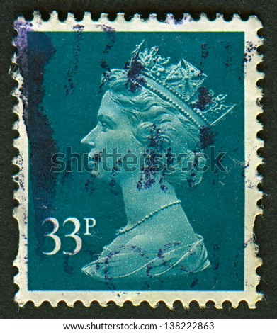 UK-CIRCA 2000: A stamp printed in UK shows image of Elizabeth II is the constitutional monarch of 16 sovereign states known as the Commonwealth realms, in Grey Green, circa 2000. - stock photo