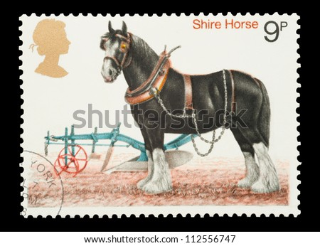 UK - CIRCA 1978: Mail stamp printed in the UK featuring a traditional working Shire Horse and plough, circa 1978 - stock photo