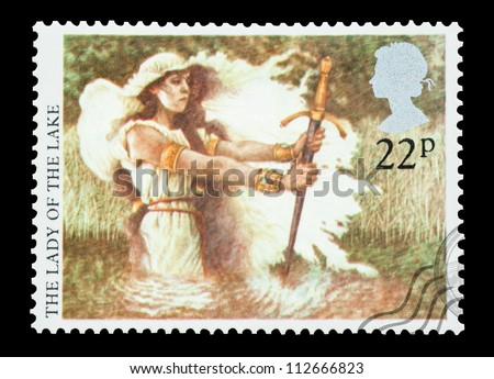 UK - CIRCA 1985: Mail stamp printed in the UK featuring the Arthurian Legend; Lady Of The Lake with the excalibur sword, circa 1985 - stock photo