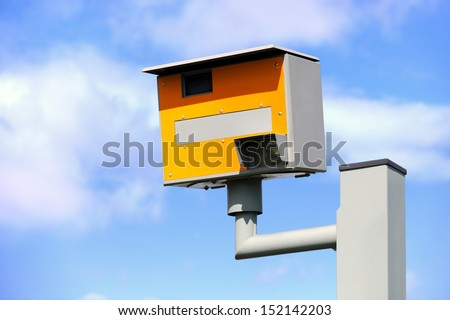 UK static speed or safety camera against a blue sky - stock photo