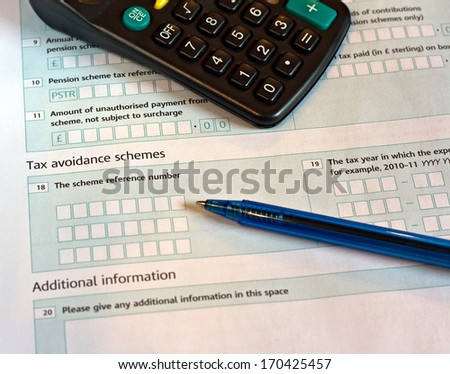 UK tax return, focus on the word Tax. - stock photo