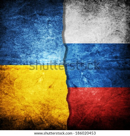 Ukraine and Russia Flag on grunge wall - stock photo