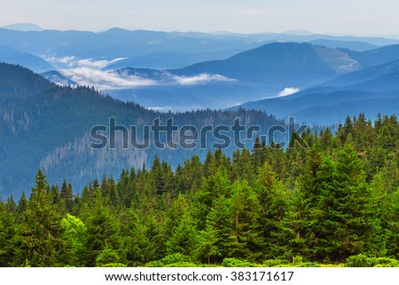 ukraine, carpathian mountains in a blue mist - stock photo