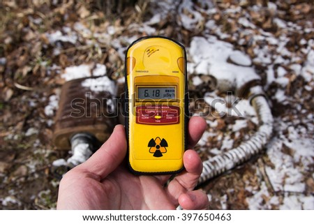 UKRAINE. Chernobyl Exclusion Zone. - 2016.03.19. Dosimeter on the background of snow-covered mask - stock photo