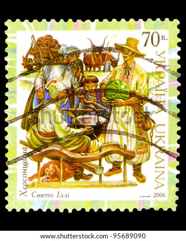 "UKRAINE - CIRCA 2006: A stamp printed in Ukraine shows Kherson Cossacks at Rest, with inscription ""Kherson Region, Ilya Holiday"", series ""Regional Folk costumes"", circa 2006 - stock photo"