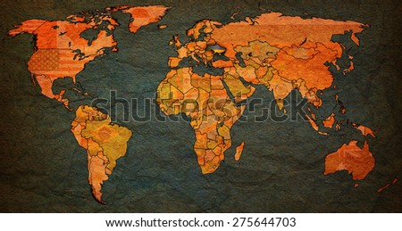 ukraine flag on old vintage world map with national borders - stock photo