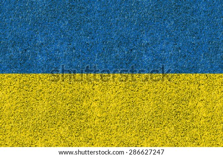 Ukraine flag texture on green grass in the garden for background - stock photo