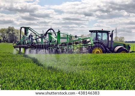 UKRAINE. 03 JUNE 2016. farmer wheat field spraying herbicides. UKRAINE. 03 JUNE 2016 - stock photo