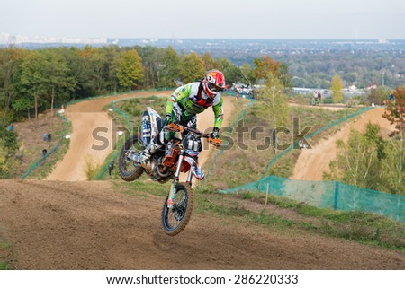 Ukraine, Kiev - October 13, 2012, European nations motocross, rider jumping - stock photo
